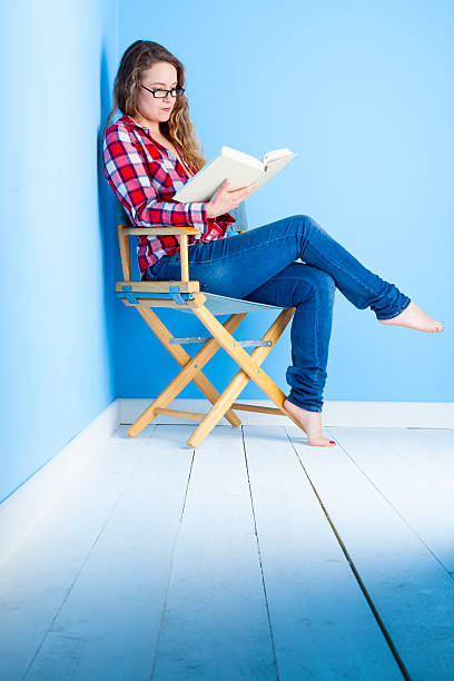 Long-haired Lady reading A Book stock photo
