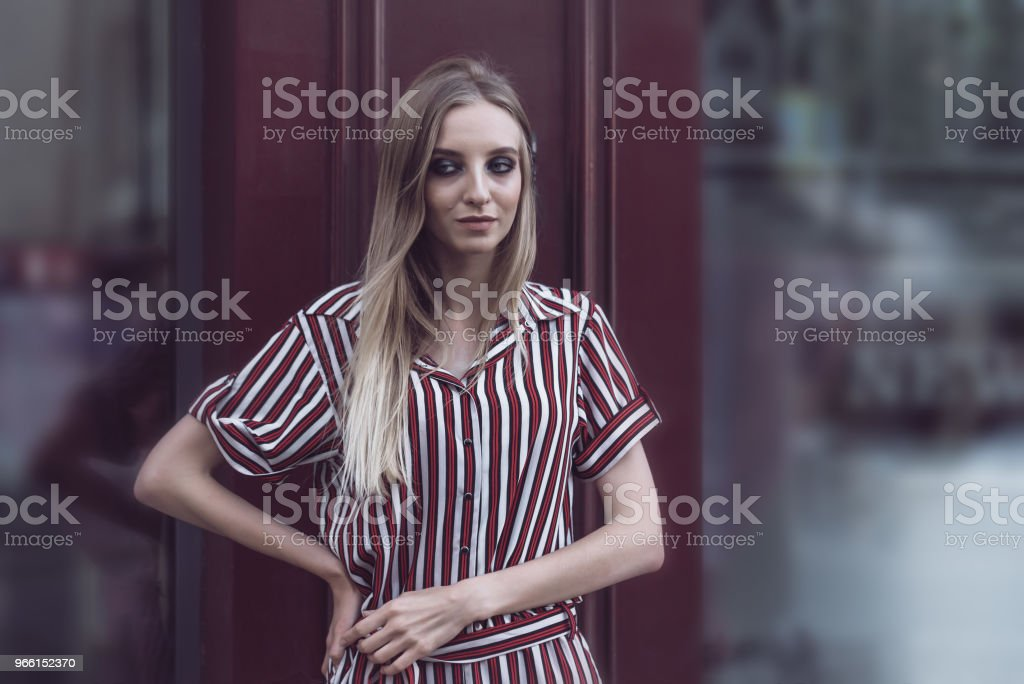 Long-haired model poses outside vintage cafe - Royalty-free Adult Stock Photo