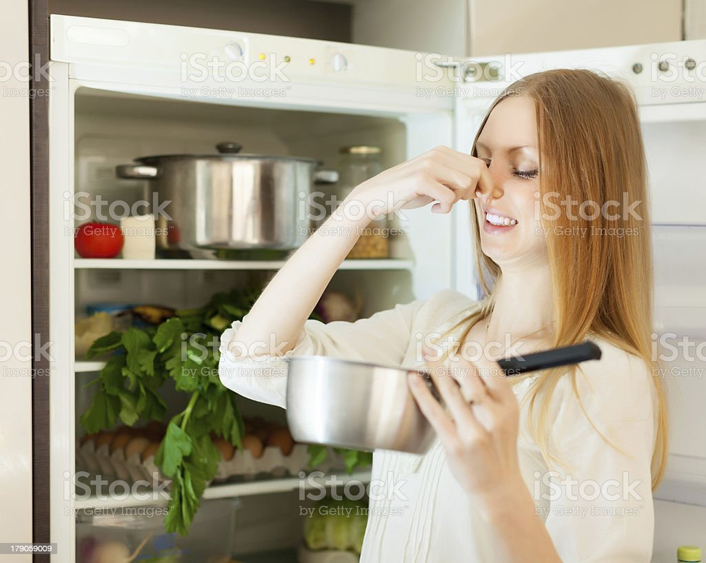 Long-haired woman  holding foul food royalty-free stock photo