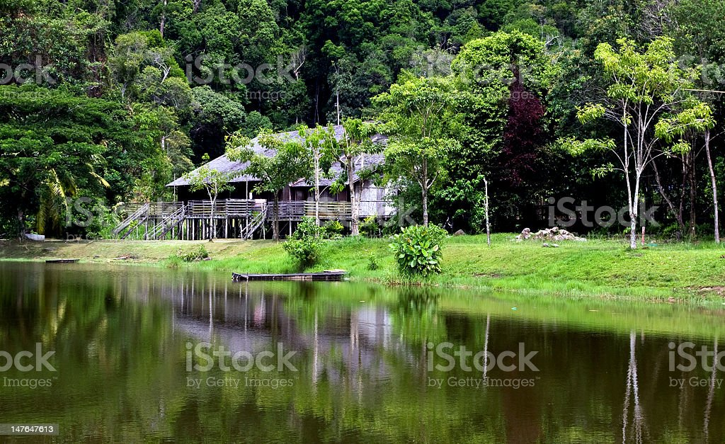 Longhouse in the middle of a natural environment with a lake stock photo