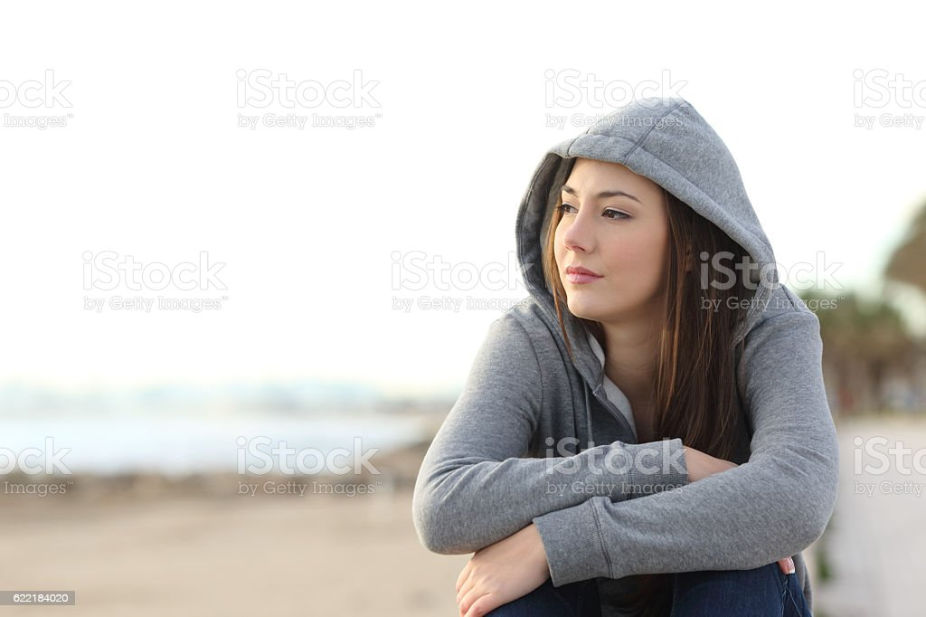 Longing pensive teenager looking away stock photo
