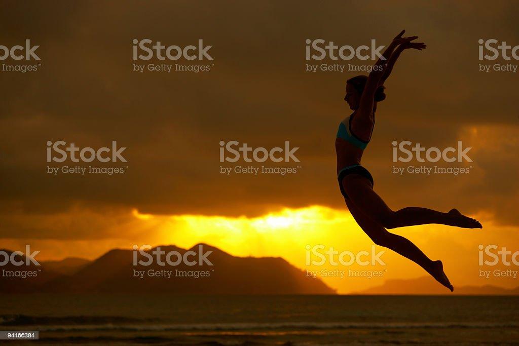 longjump at sunset royalty-free stock photo