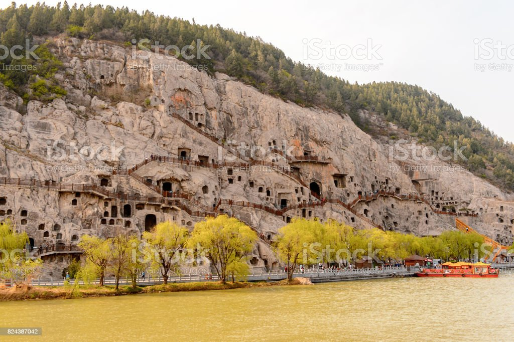 Longmen Grottoes ( Dragon's Gate Grottoes) or Longmen Caves.UNESCO World Heritage of tens of thousands of statues of Buddha and his disciples stock photo