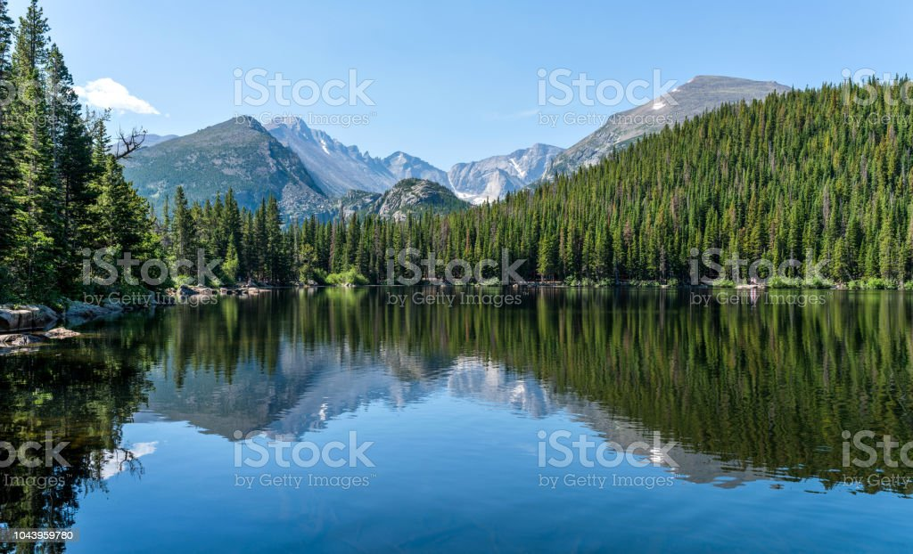 Longs Peak at Bear Lake - Longs Peak and Glacier Gorge reflecting in blue Bear Lake on a calm Summer morning, Rocky Mountain National Park, Colorado, USA. stock photo