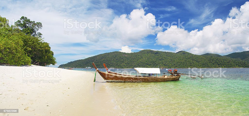 longtail boat and beautiful beach with white sand royalty-free stock photo