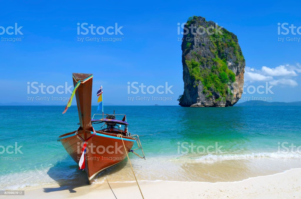 Longtail boat on Poda island beach with the famous Ko Ma Tang Ming rock stock photo