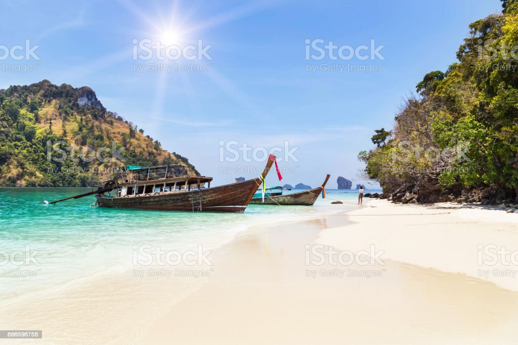 longtail boat with small island in andaman sea royalty-free stock photo