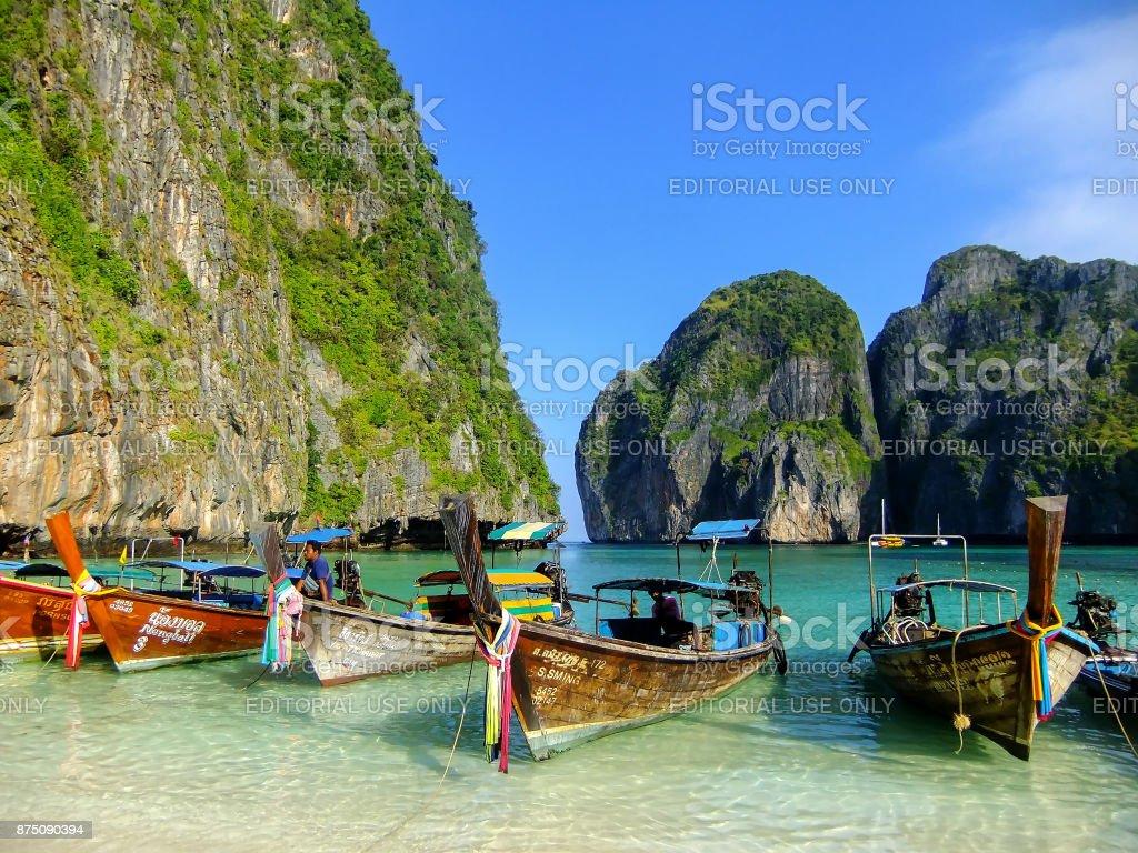 Longtail boats anchored at Maya Bay on Phi Phi Leh stock photo