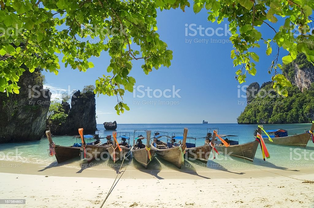 Longtail Boats at the beach on Krabi tropical island stock photo