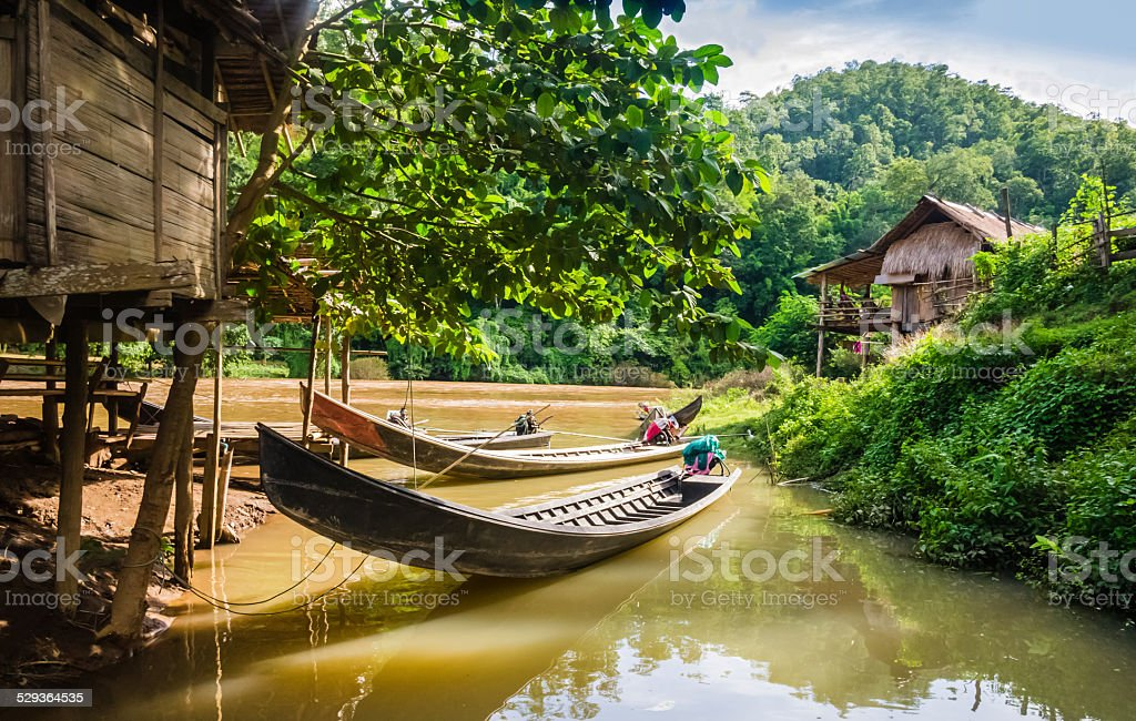 Long-tail boats moored in a village, Thailand stock photo
