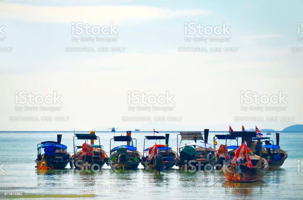 Longtail boats mooring at Loh Dalum bay stock photo