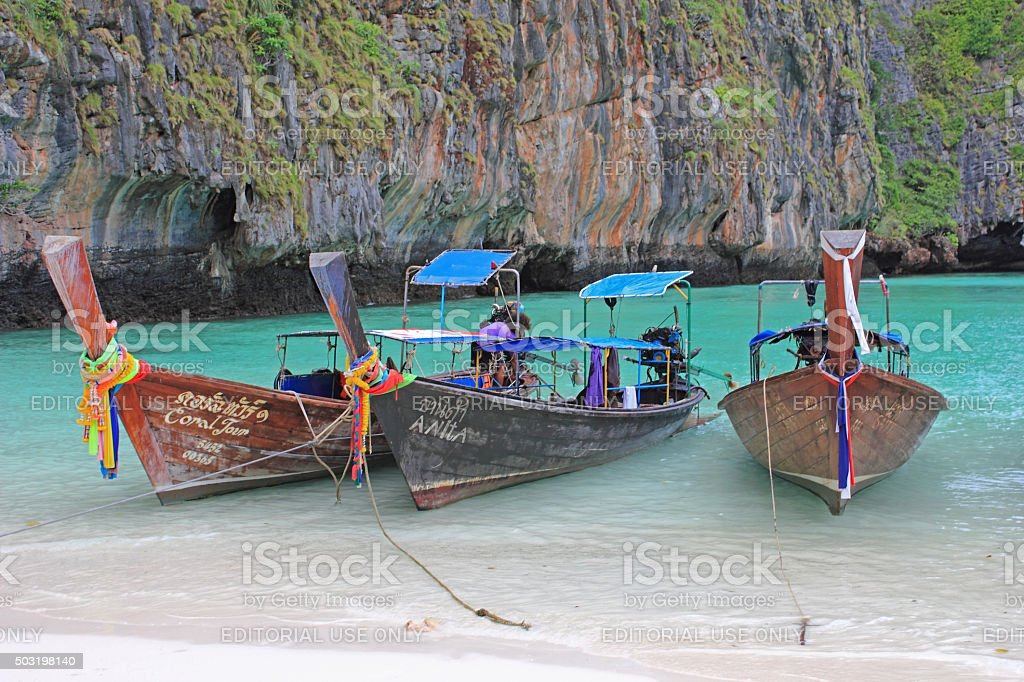 Longtail boats on tropical beach, Thailand stock photo