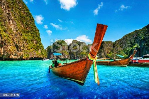 istock A Longtail Wooden Boat at Maya Bay, Thailand 186798175