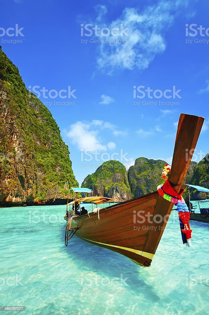 Longtail Wooden Boat at Maya Bay, Thailand stock photo