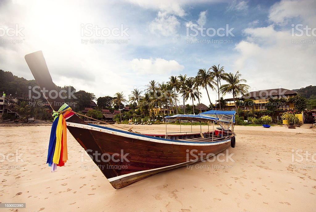 Longtailboat in Thailand on the beach stock photo