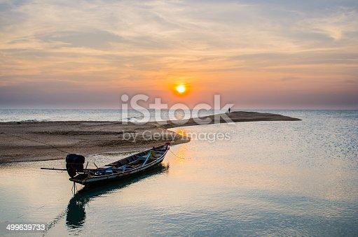 Sunset with old ruin of pier on the beach at Koh-nokpao, Surat thani, Thailand.