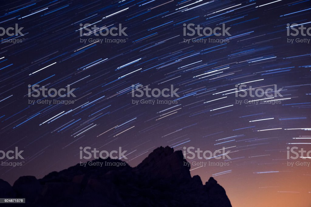 Longtime Exposure of Stars above Volcanic Landscape of Teide National Park, Tenerife, Spain stock photo