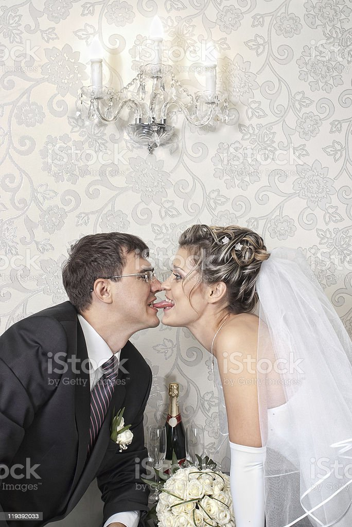 long-tongued bride with groom royalty-free stock photo
