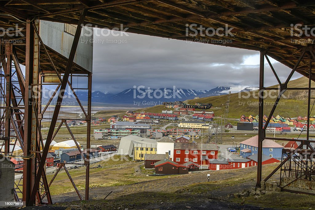 Longyearbyen seen from residues of a mine at Svalbard. royalty-free stock photo