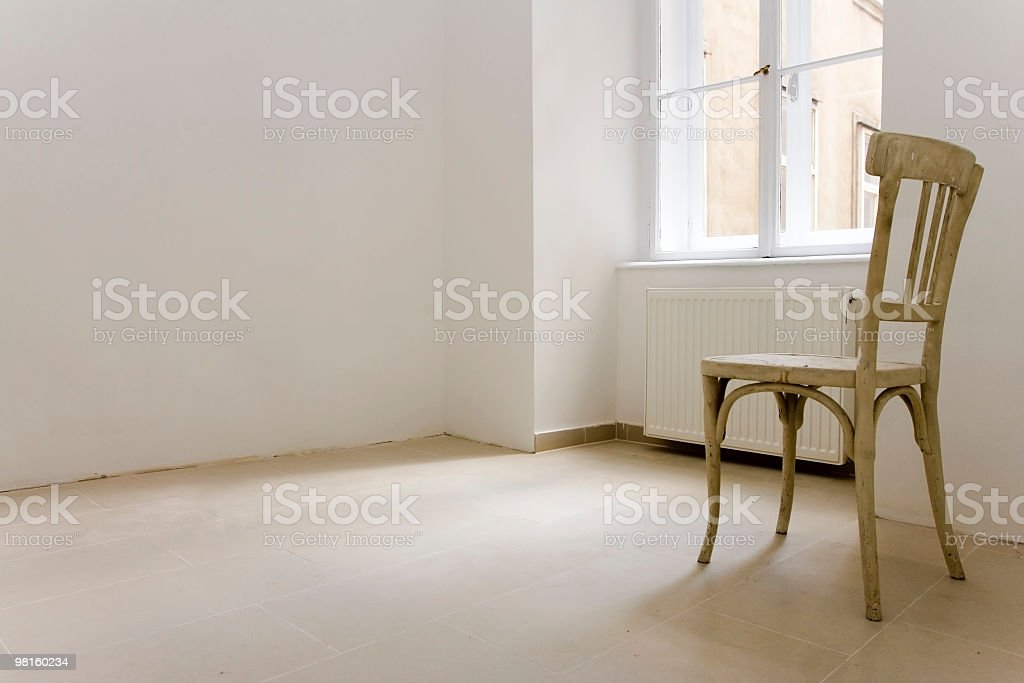 lonley chair in abandoned apartment royalty-free stock photo