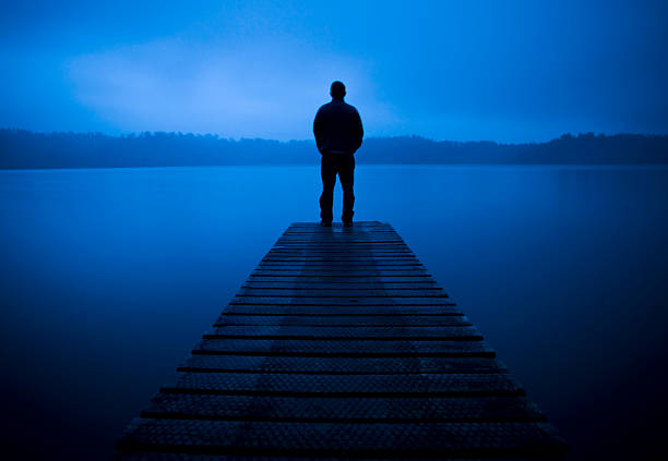 Lonley man stood at the end of a Pier  suicide stock pictures, royalty-free photos & images