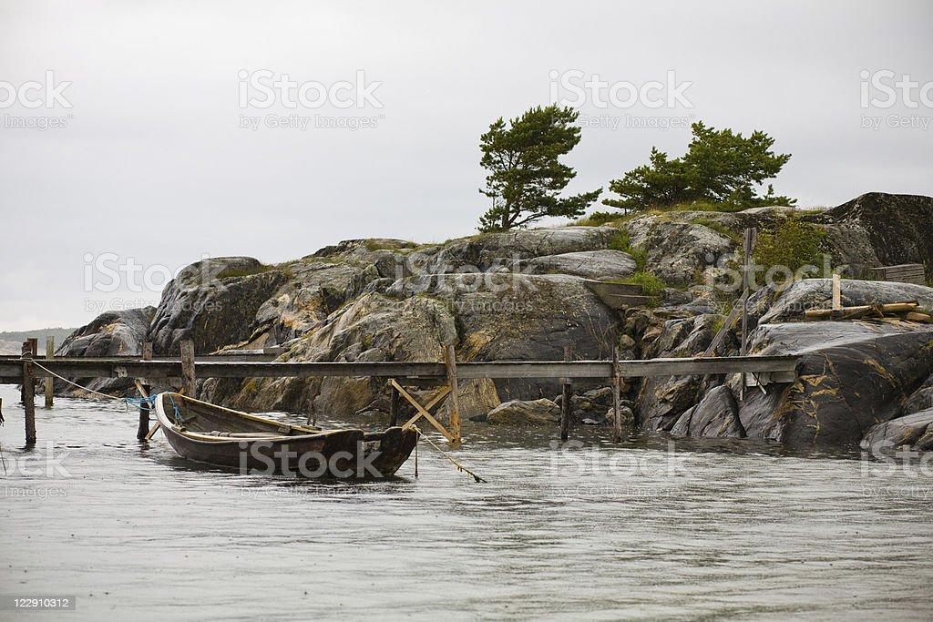 lonly fish boat stock photo