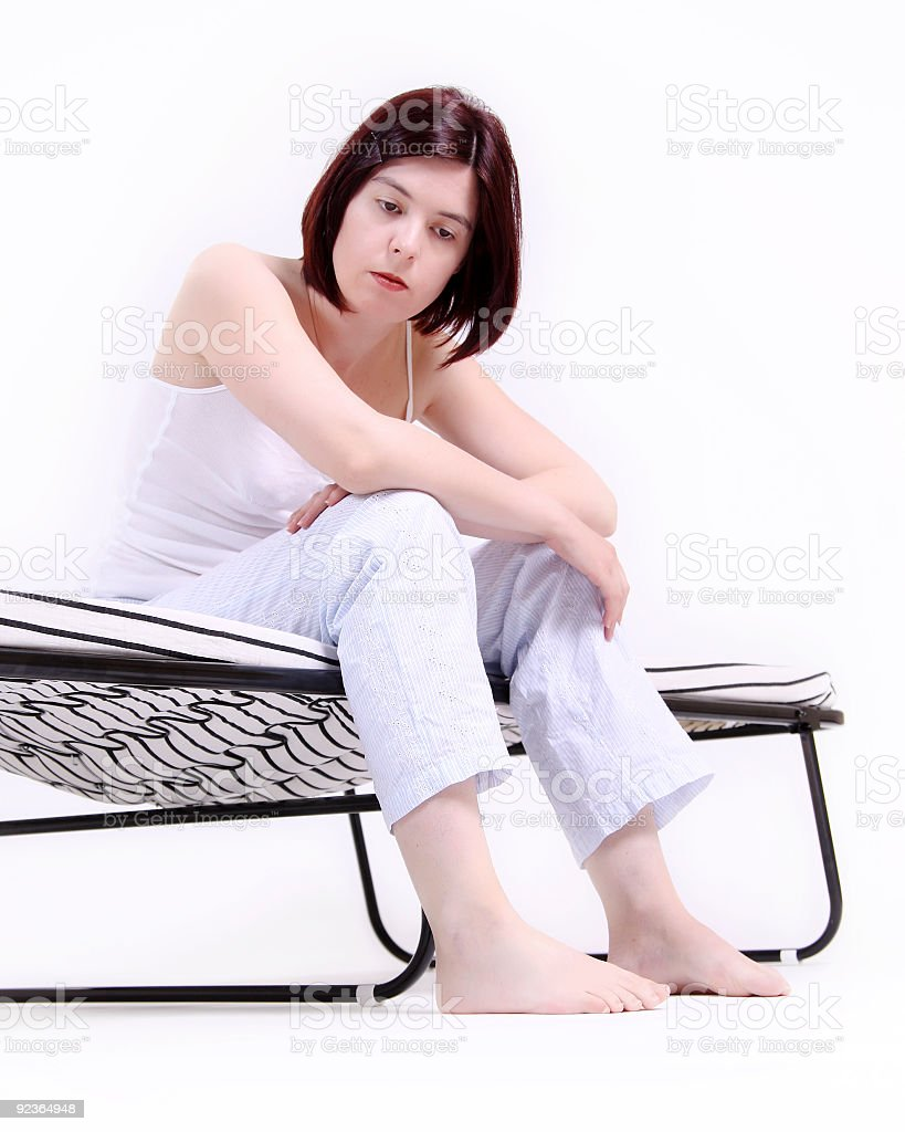 Lonly girl sittong on a bed royalty-free stock photo