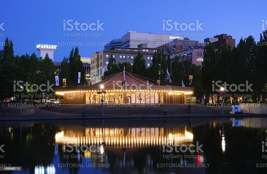 Looff Carousel along Spokane River with downtown in distance stock photo