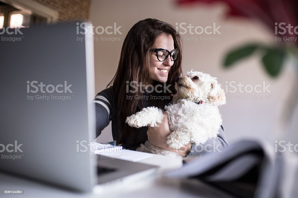 Look at me little one. Woman and her dog stock photo