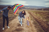Parents making their child happier while playing with kite