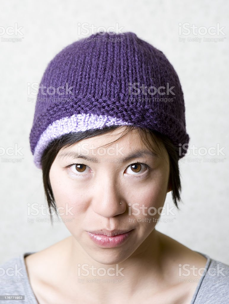 Look at my purple beanie - young woman portrait royalty-free stock photo