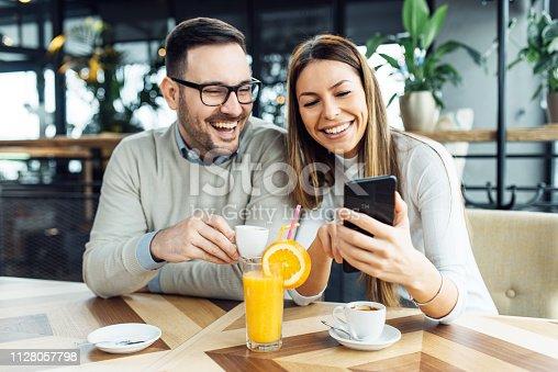 Couple browsing through their old funny photos