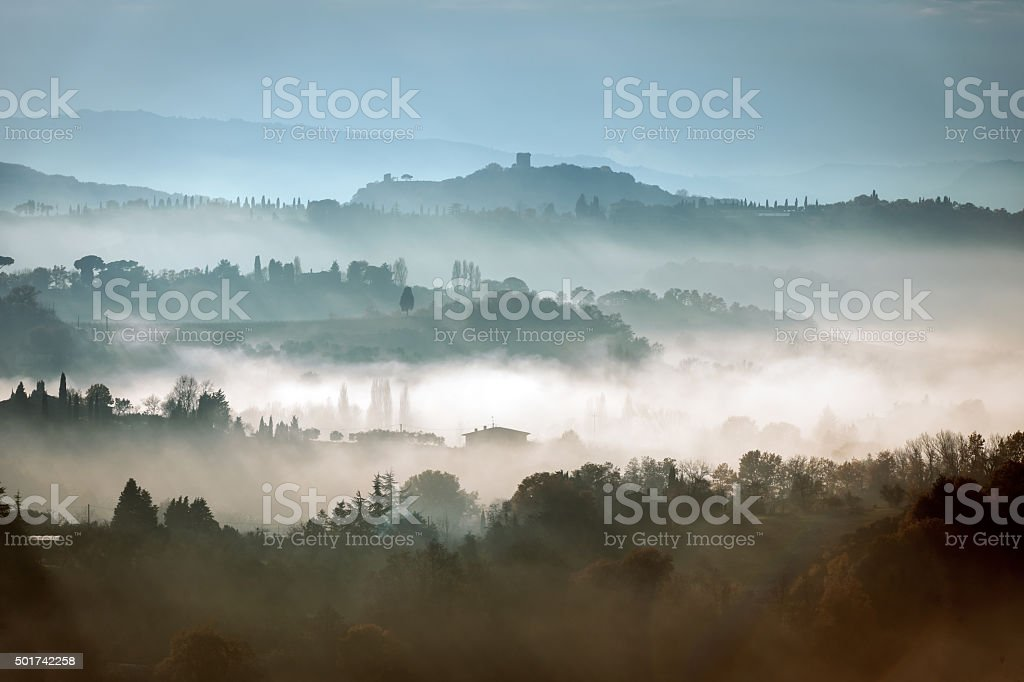 Look at the foggy landscape, Montepulciano, Tuscany,Italy stock photo