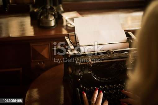 istock Look at the paper on the old typewriter. 1015055468