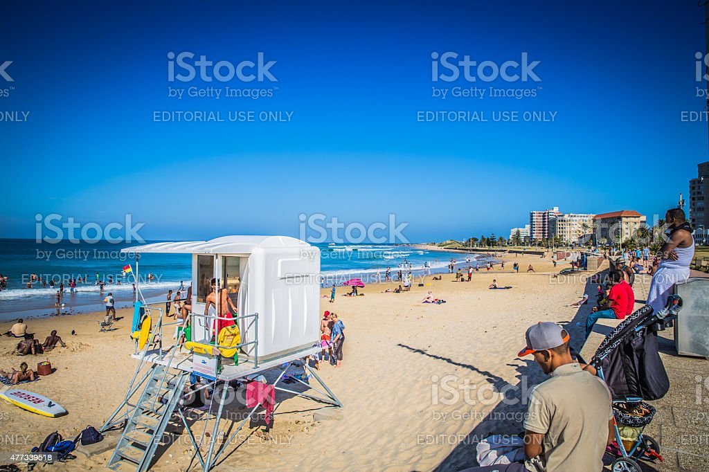 Look at the people on the beach stock photo