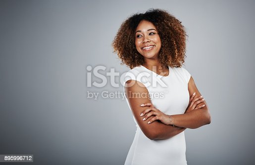 Studio shot of a young businesswoman against a gray background