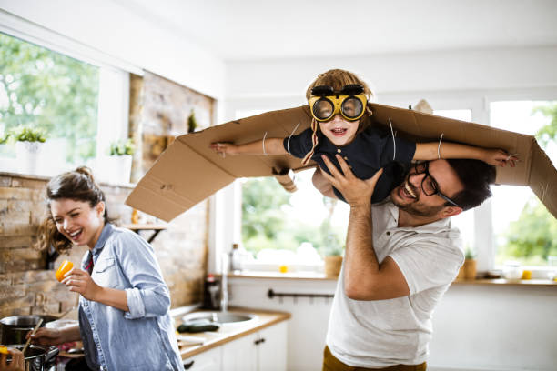 Look daddy, I'm an airplane! stock photo
