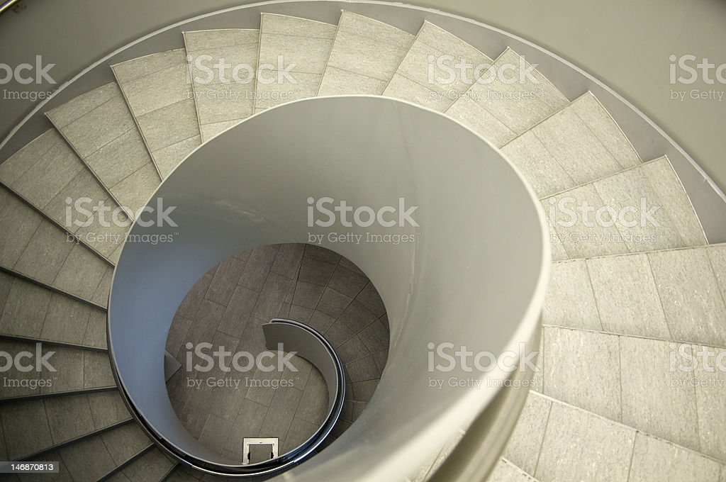Look down a spiral Staircase stock photo