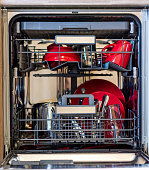 Look into dishwasher with the clean dish. Clean plate placed in kitchen cleaning machine