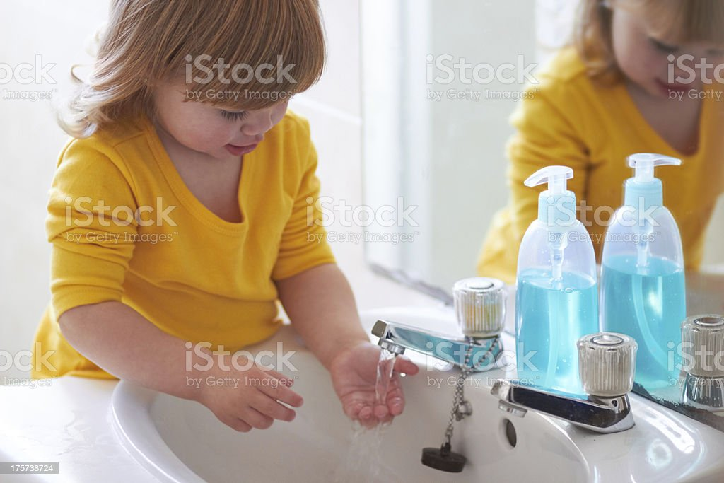 Look, it's running through my fingers! stock photo