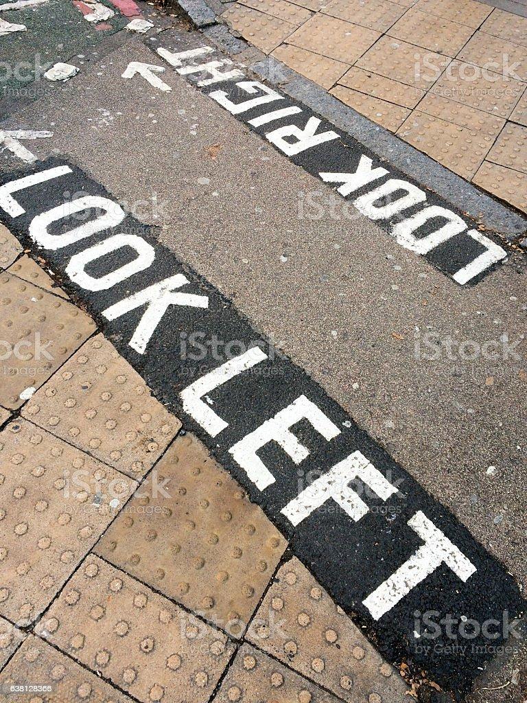Look left, written on the street in London UK stock photo