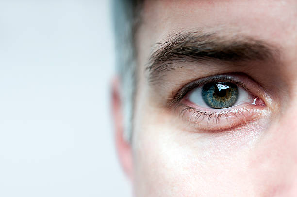 Look me in the eye Detail of a man's face blinking stock pictures, royalty-free photos & images