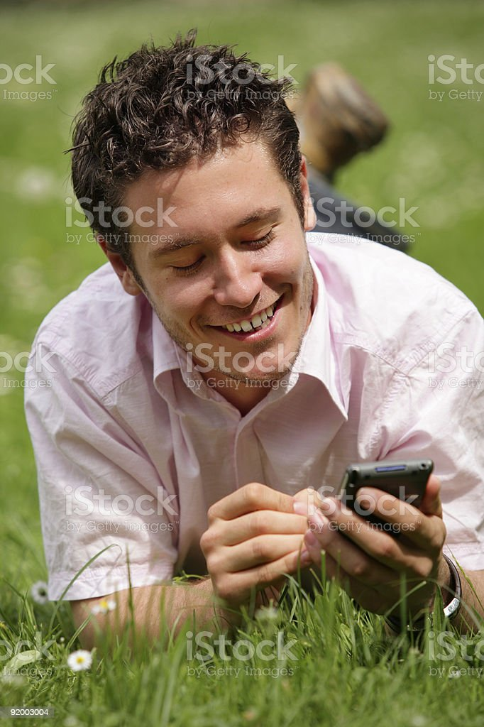 look my phonebook or do some work in the park royalty-free stock photo