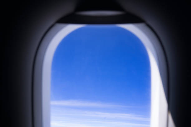 look out from the window, plane flying in the sky stock photo