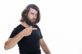 istock Look over there. Young handsome man with beard pointing away isolated on white copy space 958339430