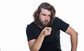 istock Look over there. Young handsome man with beard pointing away isolated on white copy space 958341002