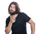 istock Look over there.Young handsome man with beard pointing away isolated on white copy space 958339758