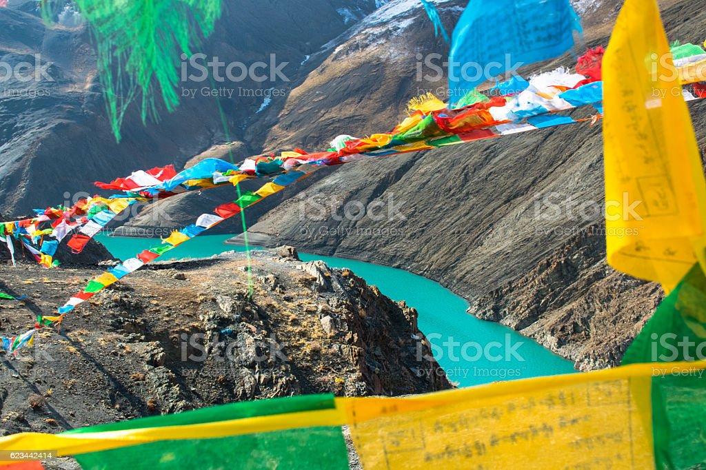 look through the prayer flags in the Himalaya, Tibet stock photo