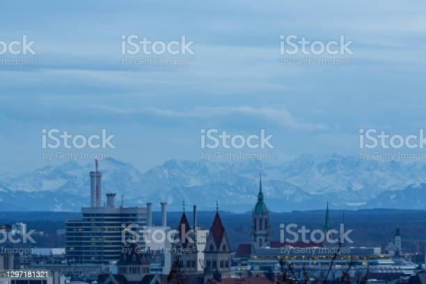 Photo of A look to the east side of Munich in Germany with the alps in the background