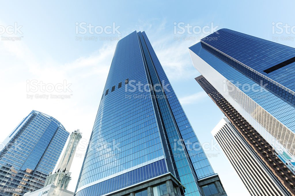 look up modern office building in cloud sky stock photo